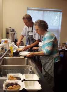Judy and Robert serving up something good at the 10th Annual Festival of Fruit; September 24, 2016 at the Carkeek Park ELC